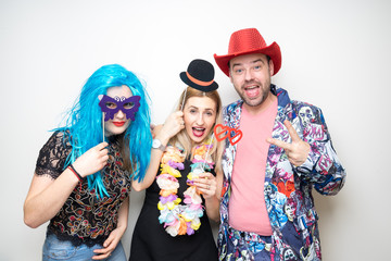 three people funny props pose photo booth happy fun bottle