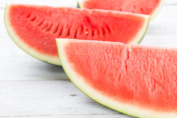 Watermelon on wooden table background