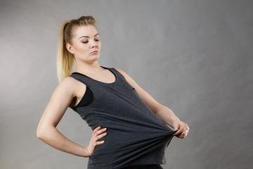Woman wearing too big tshirt