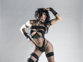 Sexy bdsm woman body at white wall