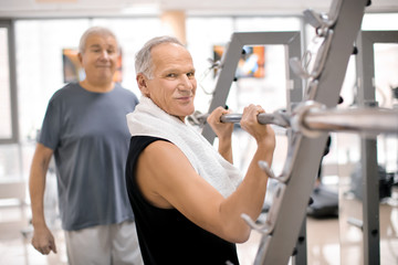 Elderly people in modern gym