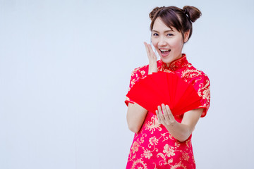 Asian woman holding red envelope, woman wear cheongsam, chinese new year