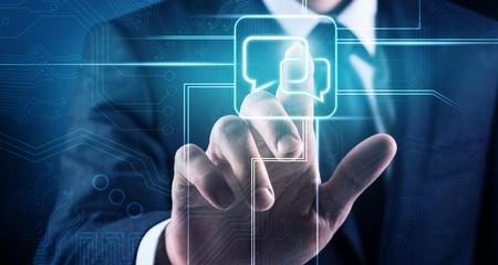 Businessman touches virtual communication icon