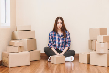 Young woman with cardboard box at home - Business online and delivery concept
