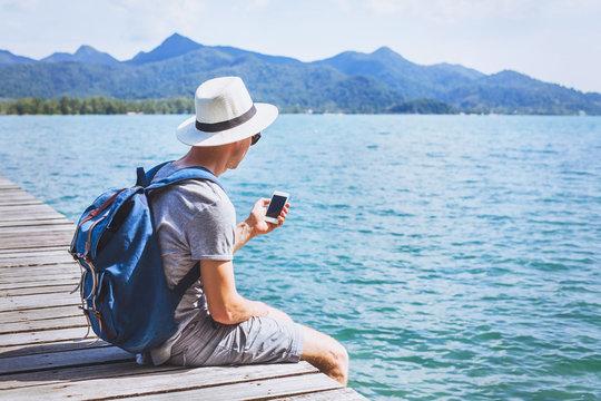 tourist traveler using mobile phone, smartphone app for traveling