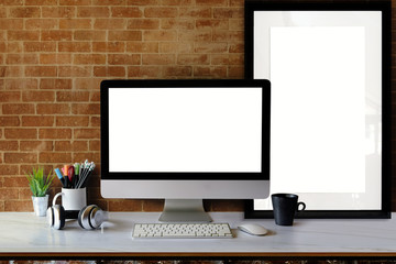 Modern clean workspace mockup with blank screen desktop computer and poster on table.