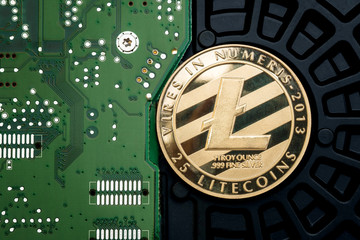 Gold metallic litecoin on electronic circuit motherboard.crypto currency mining.Digital money on blockchain network.