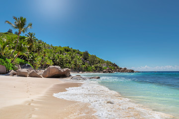 Wall Mural - Beautiful sunny tropical beach on the paradise island in Seychelles.Summer vacation and holiday travel concept.
