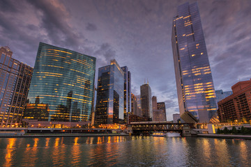 Chicago city skyline and Chicago river at dusk, Chicago, Illinois.