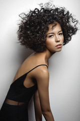 Beautiful woman with afro curls hairstyle