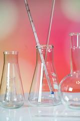 Microscope with lab glassware, science laboratory research concept