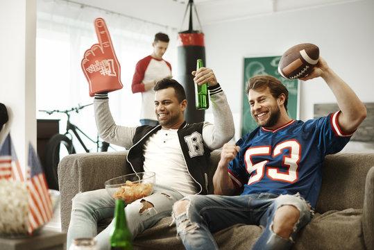Football fans giving a cheer to their sport team
