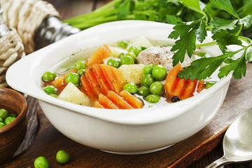 Chicken soup with green peas
