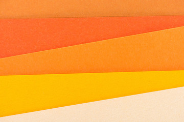 close-up shot of orange shades paper layers for background
