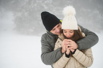 Couple going cold sheltered in winter outdoors