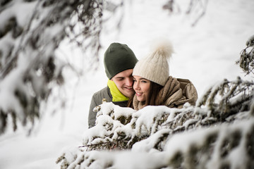 Young couple in love - snowy background.
