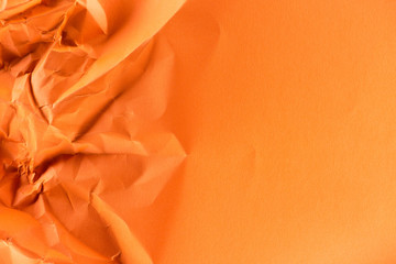 close-up shot of orange crumpled paper for background