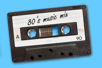 80's music mix written on vintage audio cassette tape, blue background