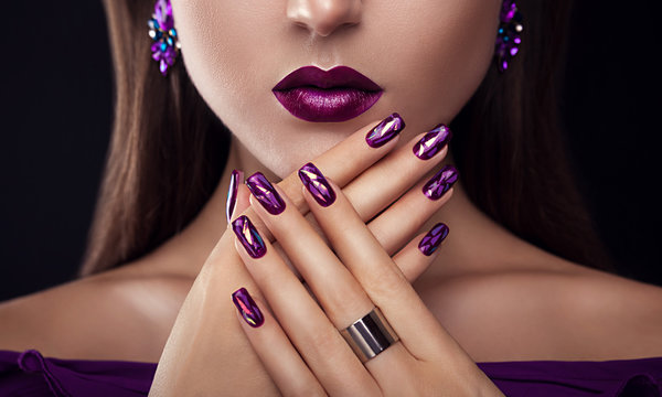 Beautiful woman with perfect make-up and manicure wearing jewellery