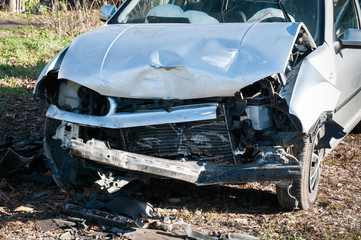 Car crash. Front side of broken and damaged car in crash accident with fatal outcome in collision