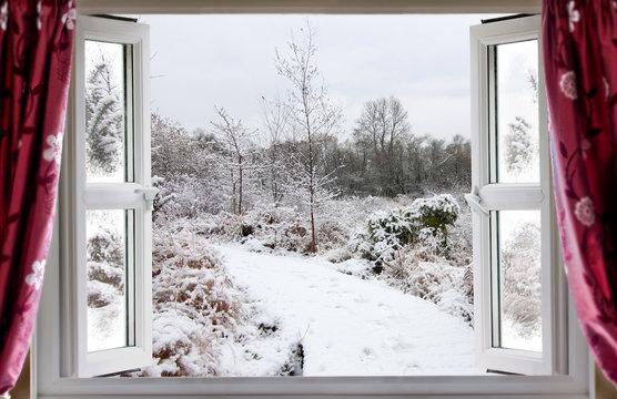 Beautiful snow path scene through an open window