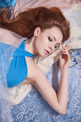 sensual beautiful girl in colored fabrics