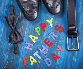 Composition for Father's day with inscription on blue background