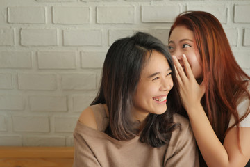 woman gossiping, whispering, listening to positive rumor or hearsay