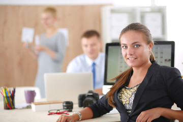 Portrait of an attractive young businesswoman sitting in front of a computer.businesswoman .