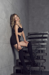 Blonde with curls in studio in loft style