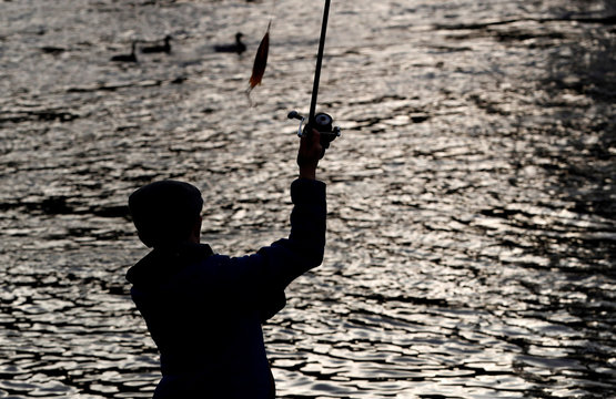 An angler casts his line on the opening day of the salmon fishing season on the River Tay at Kenmore in Scotland