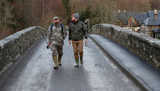 Anglers walk across the bridge at Kenmore on the opening day of the salmon fishing season on the River Tay at Kenmore in Scotland