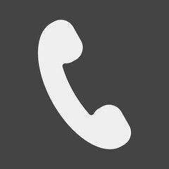 Handset vector icon. Phone icon in flat style on grey background