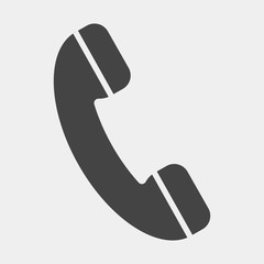 Handset vector icon. Phone icon in flat style on light-grey background