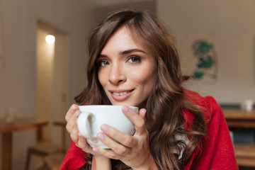 Portrait of a smiling woman holding cup