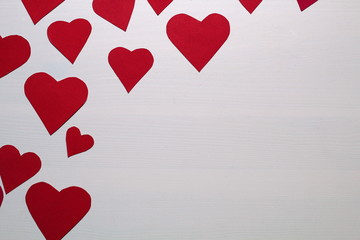 Paper baked red hearts on a white background.