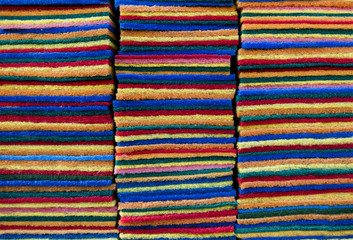 Multi-colored sponges cleaning pad for kitchen work with stack overlapping a lot of. For design work texture and background.