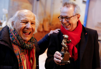 Berlinale International Film Festival director Dieter Kosslick holds a 1950 Berlin Bear award prototype beside Hermann Noack, owner of the Noack foundry during a media event for the upcoming film festival at the Noack foundry in Berlin