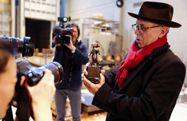 Berlinale International Film Festival director Dieter Kosslick holds a 1950 Berlin Bear award prototype during a media event for the upcoming film festival at the Noack foundry in Berlin