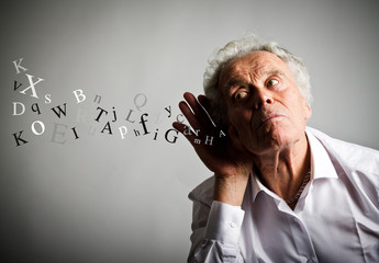 Curious old man in white and letters.
