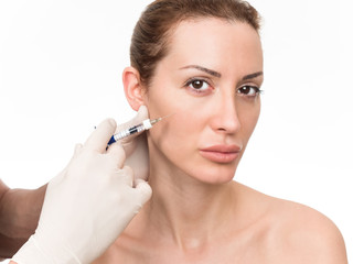 Closeup of beautiful woman receiving hyaluronic acid treatment. Isolated over white background.