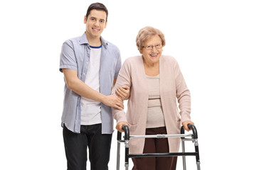 Young man holding a mature woman with a walker