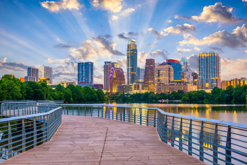 Austin, Texas, USA cityscape on the river and walkway.