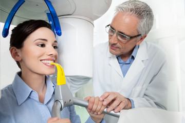 Young woman having panoramic digital X-ray with a the dentist