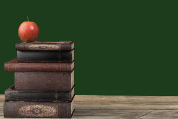 the book is on the table and the apple is on the book