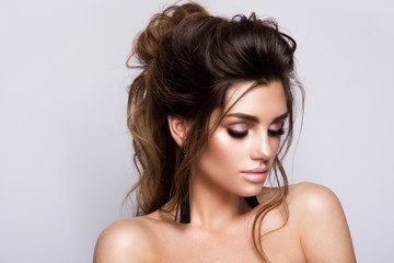 Beautiful woman with professional make up and hairstyle