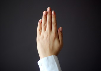 Young Woman's Hand Shows Five Fingers Gesture.