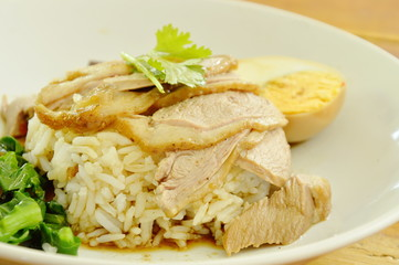 boiled duck meat slice dressing brown sauce with pickled cabbage on rice