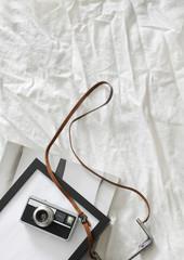 Camera, photo frame and fashion magazine