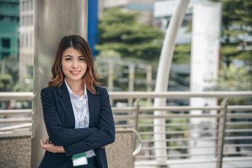 Portraits of beautiful asian woman look cheerful and confidence is standing in outdoors while feeling success with work.